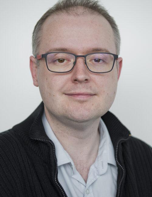 Trustee Dr John McAlaney